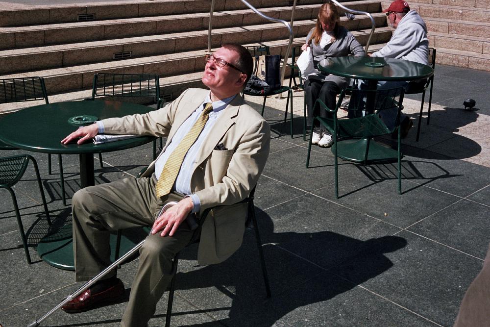 04-A-well-dressed_man_enjoying_the_sun