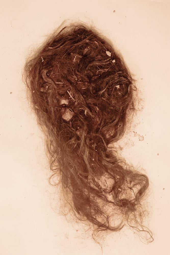 Several locks of a female garment worker's hair